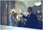 President George W. Bush and Laura Bush light a candle at St. John Episcopal Church in Washington, D.C., during a private service of prayer and remembrance Wednesday morning, September 11, 2002.