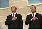 Attending the Pentagon Observance ceremony, President George W. Bush and Secretary of Defense Donald Rumsfeld say the Pledge of Allegiance before speaking Tuesday, Sept. 11, 2002.