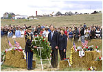 President George W. Bush and Laura Bush participate in a wreath-laying ceremony near the site of the crash where seven crew members and 33 passengers died when the plane crashed in Somerset County. Officials believe the plane was heading for a target in Washington, D.C., when the passengers fought back against the four hijackers.