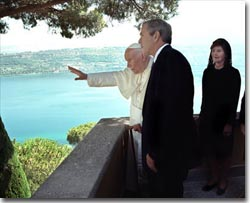 President Bush and Mrs. Bush visit His Holiness Pope John Paul II at Castel Gondolfo in Rome July 23. After posing for pictures, the two leaders took a short walk together and talked privately. White House photo by Eric Draper.