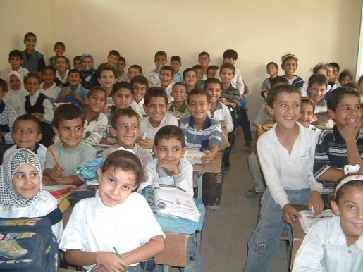 Iraqi boys and girls are excited to learn in their first year of school without Saddam.