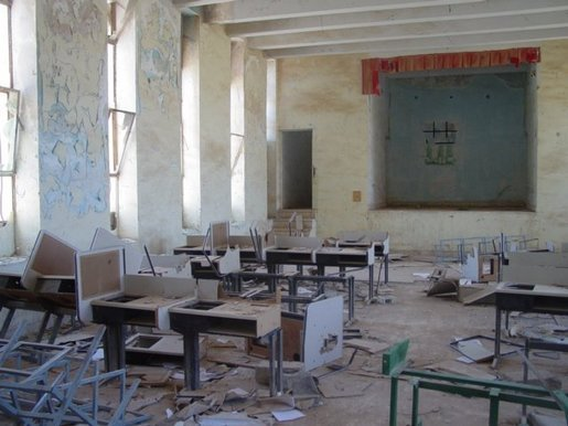 In addition to neglect, Saddam stored weapons and artillery in many schools. Saddam's soldiers also destroyed schools during the war as they used them as a base. Schools and other buildings were also looted.