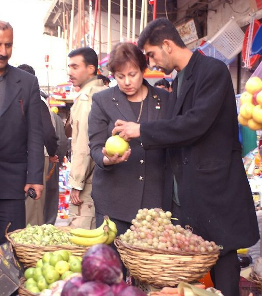 "Agriculture Secretary Ann M. Veneman tours market in Erbil, Iraq. ""The people of Iraq need to restore their way of life, and we are ready to help them be a part of the global system,"" said Veneman."