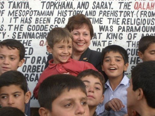 Agriculture Secretary Ann M. Veneman with children in Iraq.