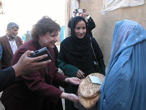 Agriculture Secretary Ann M. Veneman speaks to a woman who receives inexpensive bread from a WFP-funded women's bakery. Veneman announced, in Afghanistan, that the USDA intends to donate $5 million of U.S. agricultural commodities under the Food for Progress Program. Veneman also announced the first Cochran Fellowship Program with Afghanistan to provide short-term, U.S.-based training for eight Afghan women to study agricultural finance.