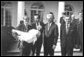 Photograph of President Nixon receiving a Thanksgiving turkey from members during the annual pardoning ceremony.