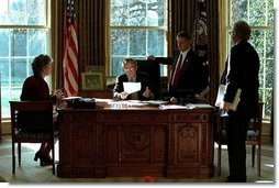 President George W. Bush meet with Karen Hughes, left, Andrew Card, center, and Karl Rove in the Oval Office Dec. 20, 2001. White House photo by Paul Morse.