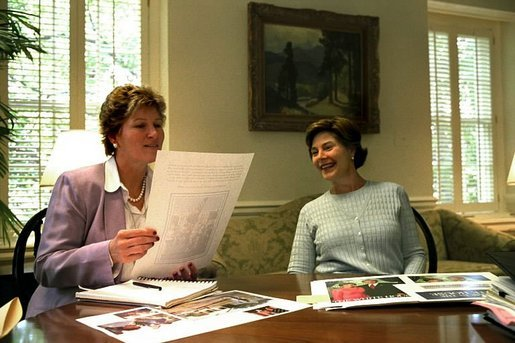 Karen Hughes and Laura Bush discuss publication layouts June 28, 2002. White House photo by Susan Sterner.