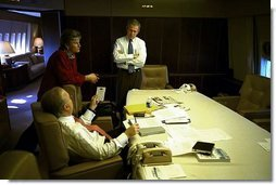 President George W. Bush meets with Karen Hughes and Karl Rove in the conference room aboard Air Force One Nov. 5, 2002. White House photo by Eric Draper.