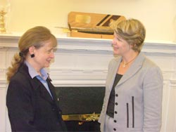 Harriet Miers, left, speaks with Margaret Spellings in the Chief of Staff's office.