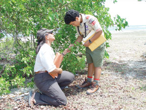 U.S. Fish and Wildlife Service biologist discusses wetland restoration with a Boy Scout in Puerto Rico. (FWS)