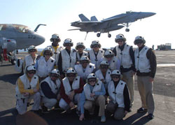 2006-2007 Fellows, in flight gear, observe operations aboard the USS Enterprise