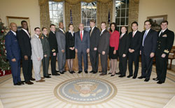 President George W. Bush poses with the 2006-2007 White House Fellows during an Oval Office meeting December 19, 2006; White House photo by Eric Draper