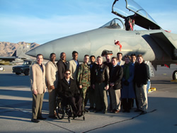 The 2002-03 White House Fellows class at Nellis Air Force Base, Nevada with an F-15 Eagle fighter jet.