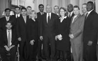 Secretary of State Colin Powell ('72-73) with the White House Fellows and Program Director Jocelyn White.