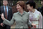 Mrs. Bush waves to members of the media and onlookers as she walks with Kiyoko Fukuda following a lunch and tea ceremony at Akasaka Palace Monday, February 18, 2002 in Tokyo.