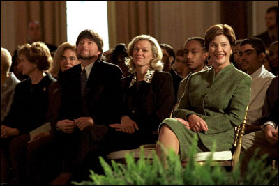 Hosting the Mark Twain Symposium, Laura Bush sits with Patricia Rowland and documentary filmmaker Ken Burns in the East Room Nov. 29, 2001.