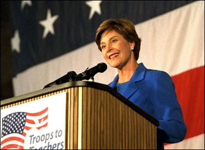 Laura Bush speaks during the <EM>Troops to Teachers</EM> rally at Wright Patterson Air Force Base in Dayton, Ohio, Oct. 16, 2002. White House photo by Susan Sterner.