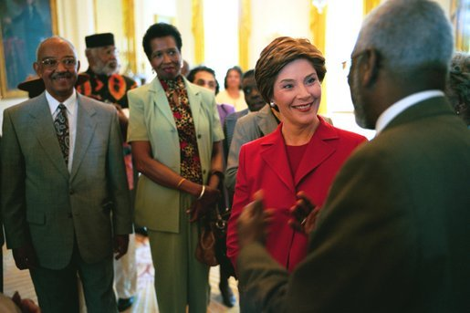 Laura Bush talks with Nathaniel Briggs, a member of the Brown v. Board of Education 50th Anniversary Commission, while Ja Delaine, left, and Joy Speakes listen in the East Room Tuesday, May 13, 2003. White House photo by Tina Hager.
