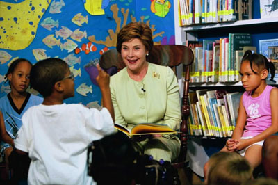 Laura Bush listens to a child's reaction to her reading of