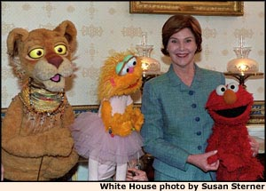 Photo of Mrs. Bush and PBS muppets. White House photo by Susan Sterner.