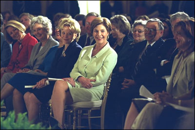 Laura Bush, Lynne Cheney and others laugh with Melissa Gilbert, right, child-star of the Little House on the Prairie Series based on Laura Ingalls Wilder books, during the White House Symposium on Women of the West, September 17, 2002. White House Photo by Susan Sterner.