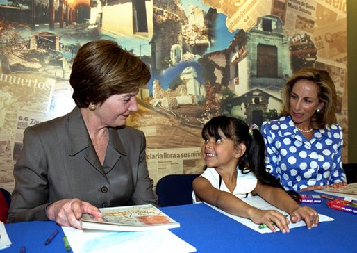 Mrs. Bush visits with earthquake victims in El Salvador, March 24, 2002. White House photo by Susan Sterner.