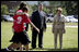 Mrs. Laura Bush and Mike Gottfried, CEO of Team Focus, watch Team Focus participants run a relay race Thursday, June 21, 2007, in Mobile, Ala., during a visit to Team Focus' National Leadership Camp, as part of Helping America's Youth initiative. Team Focus is a faith-based, nonprofit organization devoted to improving the lives of young men, ages 10-18, without fathers in their lives.