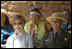 Mrs. Laura Bush and Mesa Verde National Park Superintendent Larry Wiese share a laugh, Thursday, May 23, 2006, during the celebration of the 100th anniversary of Mesa Verde and the Antiquities Act in Mesa Verde, Colorado. Also pictured are members of the Ute Mountain Ute Tribe. White House photo by Shealah Craighead.