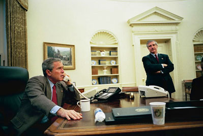 Chief Of Staff Andy Card Stands By As President George W. Bush Talks With  World