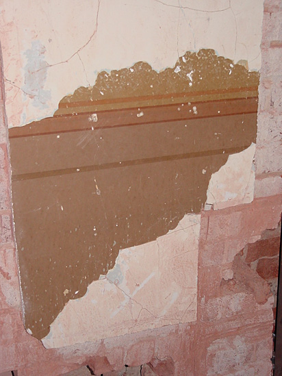 Evidence of the standard office wall finishes from 1888 was found under peeling paint in a third floor office originally for War Department staff.