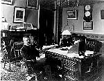 Black and white photo of then Vice President Theodore Roosevelt sitting at his desk in the Vice President's Office.