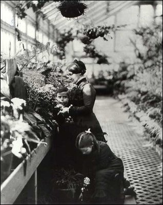 Lucy Hayes, son Scott, daughter Fannie and a friend stand in the conservatories, c.1879.
