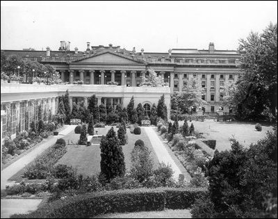 Pictured is an elevated view of the East Garden, the East Wing and Treasury Building, c. 1910.