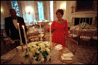 Laura Bush lights the candles for the administration's first state dinner, which welcomed Mexican President Vicente Fox and 136 guests Sept. 5, 2001. Before the 1902 renovation, the State Dining Room was 30 percent smaller and only able to accommodate 40 guests for dinner.