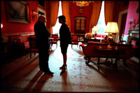 Vice President Dick Cheney and Dr. Condoleezza Rice speak in the Red Room before a press availability by the President of Pakistan Feb. 13, 2002. In contrast to the large East Room, the smaller Red Room has provided a place for quiet conversation over the years.