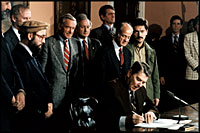 President Reagan signs the proclamation for Afghanistan Day on March 20, 1987 in the Roosevelt Room, which houses the Nobel Peace Prize awarded to Teddy Roosevelt.