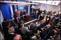 President George W. Bush and Mrs. Laura Bush participate in the ribbon-cutting ceremony to officially open the newly renovated James S. Brady Press Briefing Room Wednesday morning, July 11, 2007, at the White House.