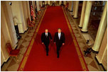 "President George W. Bush and Russian President Vladimir Putin walk out to address the media at the White House on Nov. 13, 2001. ""This is a new day in the long history of Russian-American relations, a day of progress and a day of hope,"" said President Bush in his remarks."