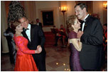 Leading their wives in the first dance of the evening, Presidents Bush and Mexican President Vicente Fox take to the floor during the state dinner held on September 5, 2001.