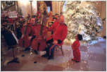 A member of the Marine Band greets a young fan in the Cross Hall during the 2001 holiday season at the White House.
