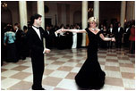 Britain's Princess Diana dances with actor John Travolta at a White House dinner on November 9, 1985.