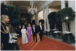 President Gerald Ford and Mrs. Ford escort Japanese Emperor Hirohito and Empress Nagako down the red carpet prior to a state dinner on October 2, 1975.