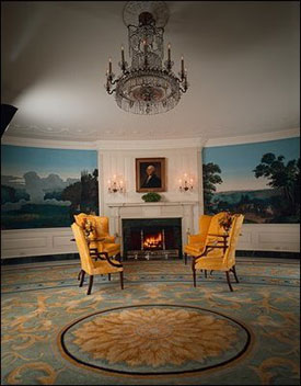 "Decorating the walls of this oval room is a panoramic wallpaper called ""Views of North"