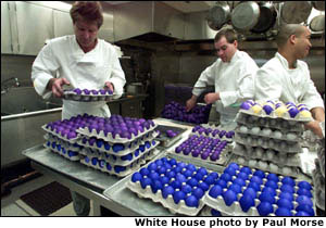 White House chefs arrange some of the thousands of dyed eggs in preparation for the annual Easter Egg Roll on the South Lawn of the White House on April 1, 2002. White House Photo by Paul Morse.