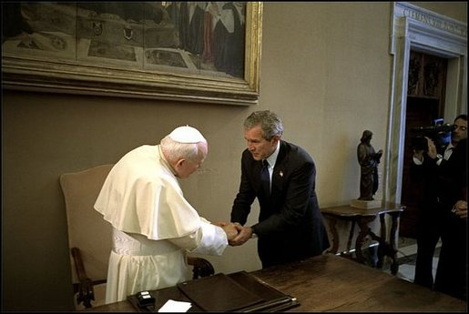 President Bush visits His Excellency Pope John Paul II at Vatican City May 28. White House photo by Eric Draper.