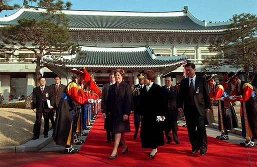 Mrs. Bush walks with the First Lady of the Republic of Korea Madame Lee Hee-ho in the Grand Garden of Chong Wa Dae (Blue House) during official arrival ceremonies in Seoul Wednesday, February 20, 2002. White House photo by Paul Morse.