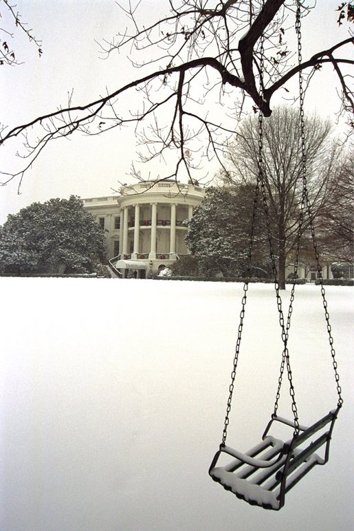 A blanket of snow covers the South Lawn of the White House, Thursday, Dec. 5, 2002. White House photo by Moreen Ishikawa.