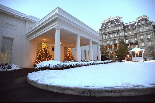 The West Wing entrance glows as the sun rises on a snowy day at the White House, Friday, Dec. 6, 2002. White House photo by Tina Hager.