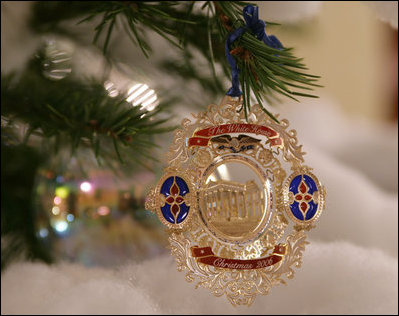 A White House Christmas Ornament Hangs From Branch On The Official Tree